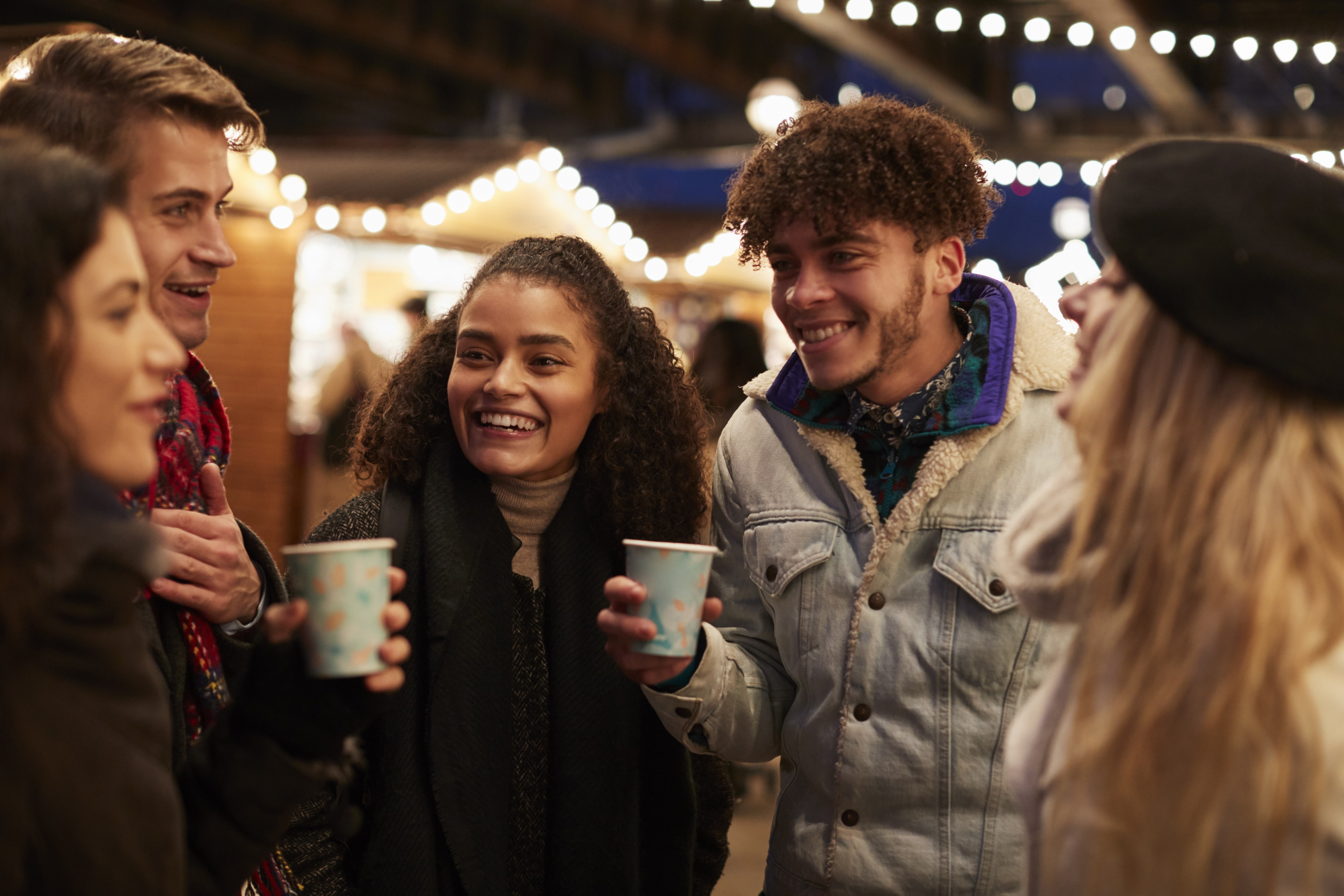 Group Of Friends Drinking Mulled Wine At PZ29EK3 (2)